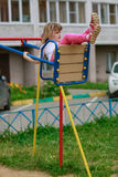 Girl riding on a swing in the Playground Stock Images