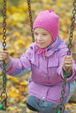 Girl riding on swing Royalty Free Stock Images