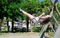 A girl riding a swing Stock Images