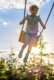 Girl riding on a swing Stock Image