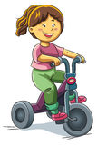 Girl Riding Tricycle Royalty Free Stock Photos