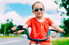 girl riding a two wheel bike Stock Image