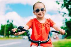 Girl riding a two wheel bike. Young girl riding a two wheel bike Stock Image