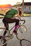 Girl riding a vintage bicycle royalty free stock photo
