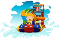 Girl riding on water slide Stock Photo