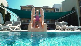 Girl riding from waterslide stock footage