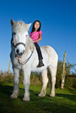 Girl ridning a horse Royalty Free Stock Images