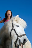 Girl ridning a horse Stock Image