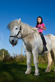Girl ridning a horse Royalty Free Stock Photography