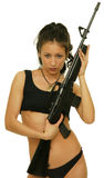 Girl with rifle. Asian girl with rifle on the white background Stock Photo