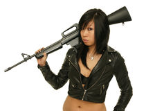 Girl with rifle. Asian girl with rifle on the white background Royalty Free Stock Images