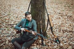 Girl with rifle. chase hunting. Gun shop. woman with weapon. Target shot. successful hunt. hunting sport. female hunter. In forest. military fashion royalty free stock images