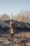 Girl with a rifle on the hunt royalty free stock photography