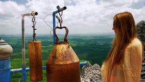 Girl ringing bells at buddhist temple. On the top of the mountain stock footage