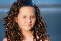 Girl with ringlets Stock Images
