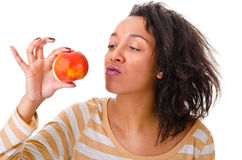 Girl with a ripe apple Stock Photography