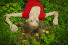 Beautiful young Girl with juicy fruit Stock Images