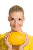 Girl with ripe melon Stock Photography