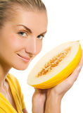 Girl with ripe melon Royalty Free Stock Photos