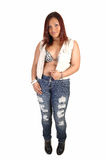 Girl in ripped jeans. Royalty Free Stock Image