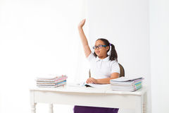 Girl rise her hand in class room Stock Image