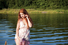 Girl on the river royalty free stock image
