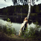 Girl and river. Portrait of romantic girl at Forest River Stock Images