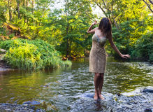 Girl  in river Royalty Free Stock Photos