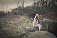 Girl by the river Royalty Free Stock Image