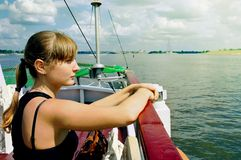 Girl on river boat sails on river Stock Photo