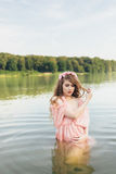 Girl in river. Girl in a dress in the water at dawn Stock Images