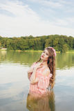 Girl in river. Girl in a dress in the water at dawn Royalty Free Stock Photography