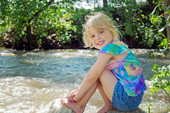 Girl on river rock Royalty Free Stock Photos