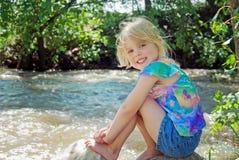 Girl on river rock Royalty Free Stock Photos