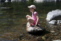 Girl On A River Rock Stock Photography
