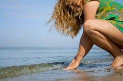 The girl on river shore Stock Photos