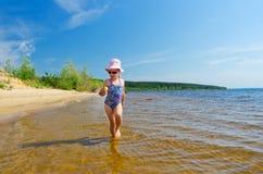 Girl at river shore Royalty Free Stock Photography