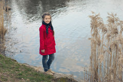 Girl river shore Royalty Free Stock Images