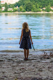 Girl at the river strand Royalty Free Stock Image