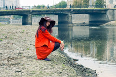 Girl on the riverbank Royalty Free Stock Photos