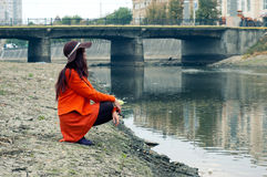 Girl on the riverbank Royalty Free Stock Image