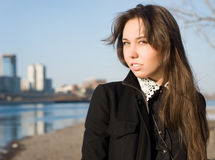 The girl on the riverbank Royalty Free Stock Photography