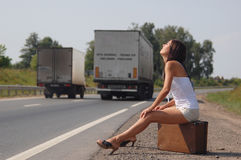 The Girl on road. Stock Photo