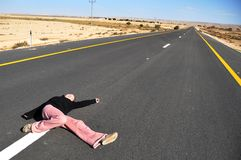 Girl on road Stock Image