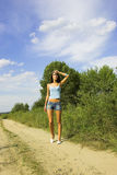 Girl on the road Royalty Free Stock Images