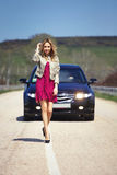 Girl on the road Royalty Free Stock Image