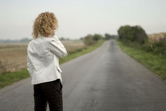 Girl on the road royalty free stock photography