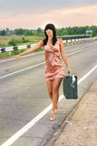 Girl on the road. Waiting for  bus Stock Photography