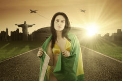 Girl on the road with Brazilian flag Royalty Free Stock Images