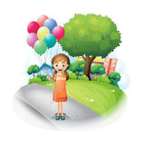 A girl at the road with eight balloons Stock Photo